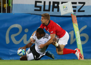 RIO DE JANEIRO, BRAZIL - AUGUST 11: Jasa Veremalua of Fiji scores a try during the Men's Rugby Sevens Gold medal final match between Fiji and Great Britain on Day 6 of the Rio 2016 Olympics at Deodoro Stadium on August 11, 2016 in Rio de Janeiro, Brazil. (Photo by David Rogers/Getty Images)
