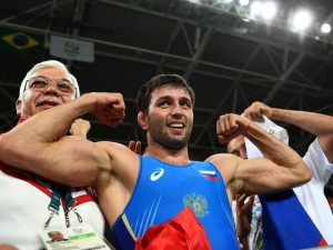 RIO DE JANEIRO, BRAZIL - AUGUST 21:  Soslan Ramonov of Russia celebrates after winning the gold in the Men's Freestyle 65kg Gold match against Toghrul Asgarov of Azerbaijan on Day 16 of the Rio 2016 Olympic Games at Carioca Arena 2 on August 21, 2016 in Rio de Janeiro, Brazil.  (Photo by Laurence Griffiths/Getty Images)