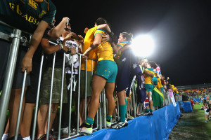 RIO DE JANEIRO, BRAZIL - AUGUST 08:  Emilee Cherry  of Australia celebrate victory after winning the Women's Gold Medal Final Rugby Sevens match between Australia and New Zealand on August 8, 2016 in Rio de Janeiro, Brazil.  (Photo by Alexander Hassenstein/Getty Images)