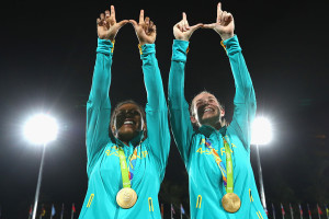 RIO DE JANEIRO, BRAZIL - AUGUST 08:  Gold medalist Ellia Green (L) of Australia  and her team mate Chloe Dalton  pose with her Gold medal  after  the medal ceremony for the Women's Rugby Sevens on Day 3 of the Rio 2016 Olympic Games at the Deodoro Stadium on August 8, 2016 in Rio de Janeiro, Brazil.  (Photo by Alexander Hassenstein/Getty Images)