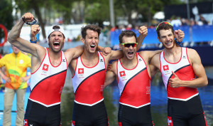RIO DE JANEIRO, BRAZIL - AUGUST 11: Lucas Tramer, Simon Schuerch, Simon Niepmann, and Mario Gyr of Switzerland celebrate after winning the gold medal in the Lightweight Men's Four Final A on Day 6 of the Rio 2016 Olympic Games at the Lagoa Stadium on August 11, 2016 in Rio de Janeiro, Brazil. (Photo by Alexander Hassenstein/Getty Images)
